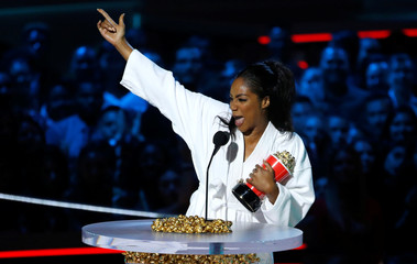 Host Haddish accepts the award for Best Comedic Performance at the 2018 MTV Movie & TV Awards at Barker Hangar in Santa Monica
