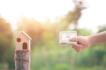 House on the hand child in nature, Concept Investment in real estate finance.