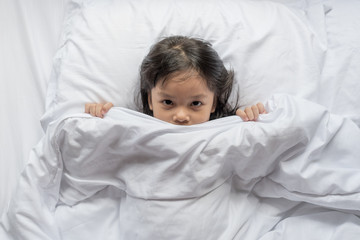 girl in white bed