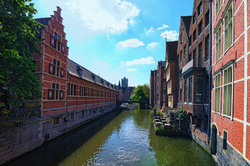 Ghent, Belgium-May 03, 2018: Houses and cafes sit on the water. Urban landscape photo. Sunny spring morning view