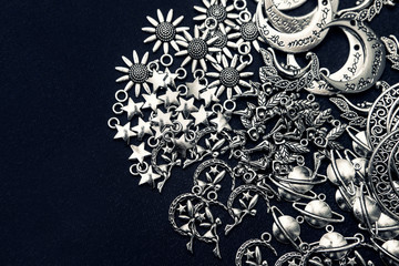 Charm pendants for crafting. Sun and moon symbols. Star and planet figures.