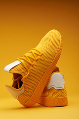 Pair of yellow sport shoes