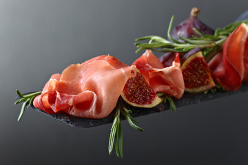 Prosciutto with figs and rosemary.