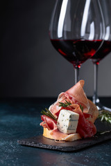 Wall Mural - Sandwich with prosciutto, blue cheese and rosemary .