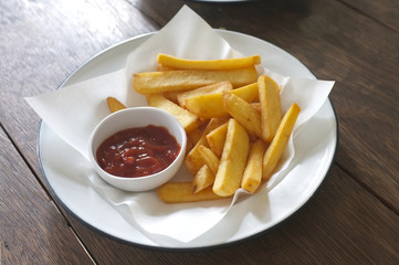 Potato fry  or French fries with ketchup on white dish