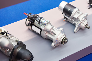 Starter motors of cars in store