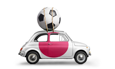 Japan flag on car delivering soccer or football ball isolated on white background