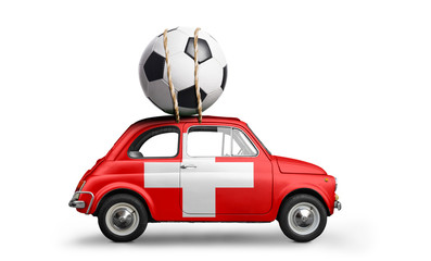 Switzerland flag on car delivering soccer or football ball isolated on white background