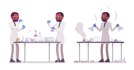 Male black scientist making chemical experiments