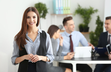 Young smiling businesswoman in conference room