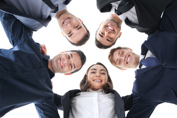 People standing together against white background, view from below. Unity concept