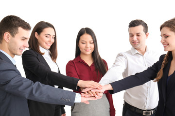People putting hands together against white background. Unity concept