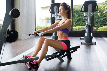 Woman doing exercise for her back - Seated cable row