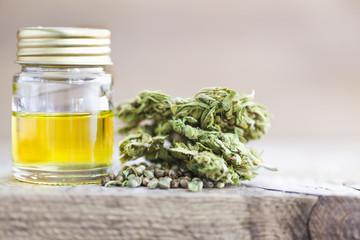 cannabis cbd product oil and hemp seeds