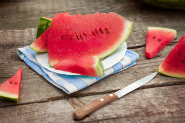 Slices of watermelon on plate with cutlery