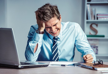 Crying man. Worker dissatisfied his earnings. Photo of young man working in the office. Business concept