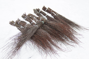 Many brooms from dry tree branches.Besom