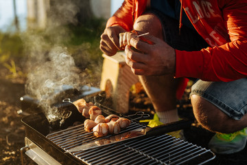 man making grill on griddle
