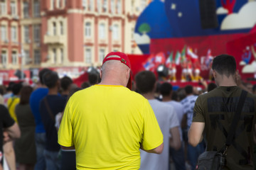 Football fan on a blurred background other fans