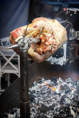 Lamb is fried on a spit over hot coals. Outdoor grill