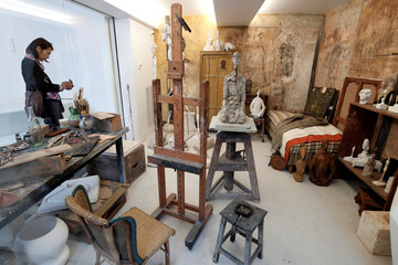 """The sculpture """"Buste d'homme assis"""" (1965-1966) is pictured in a reconstruction of the Alberto Giacometti's parisian studio during the press preview of the Giacometti Institute in Paris"""