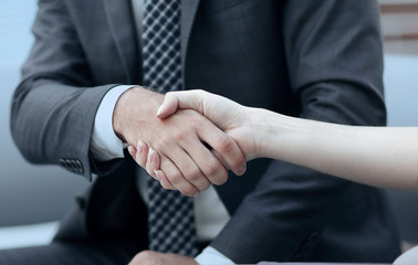 close-up handshake of business partners.