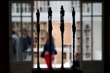 "The sculpture ""Four Women on a Base"" (1950) are seen in silhouette during the press preview of the Giacometti Institute in Paris"