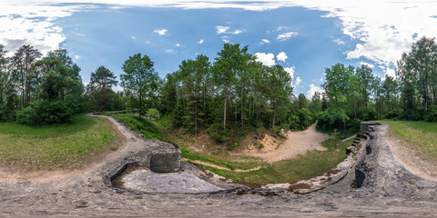 Full seamless 360 degrees angle  view panorama on the ruined abandoned military fortress of the First World War in the forest in equirectangular spherical projection. Ready for VR AR content