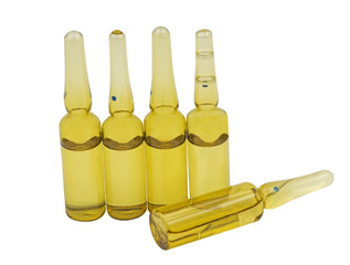 several ampoules for injection on white