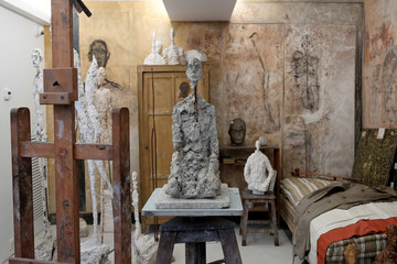 """The sculpture """"Buste d'homme assis"""" (Lotar III, 1965-1966) is pictured in a reconstruction of the Alberto Giacometti's parisian studio during the press preview of the Giacometti Institute in Paris"""