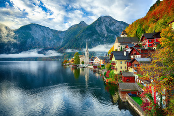 Foggy autumnal sunrise at famous Hallstatt lakeside town reflecting in Hallstattersee lake Wall mural