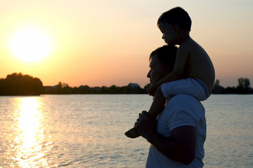 Father and son watching the sunset
