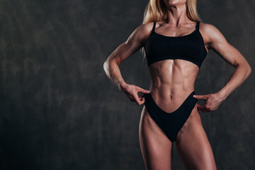 Studio Shot of a Stunning Hot Sporty Body of a Fitness Woman with Perfect Forms