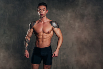 Studio Shot of a Stunning Hot Sporty Body of a Fitness Man with Perfect Forms