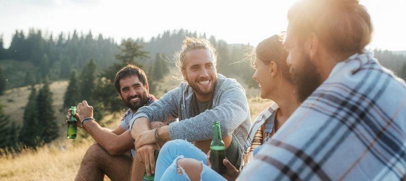 Friends Enjoying Picnic in Mountain