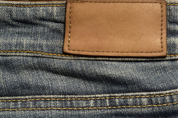 Close up on blue jeans blank label