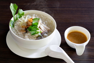 Boiled rice with sea bass in white bowl delicious food for thai breakfast and dinner