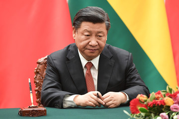 Chinese President Xi Jinping waits for his documents during a signing ceremony with Bolivia's President Evo Morales at the Great Hall of the People in Beijing