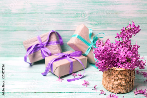 Aromatic Lilac Flowers In Vase And Boxes With Gifts On Turquoise