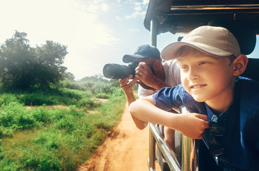 Little expiorer boy with his father on jeep safari