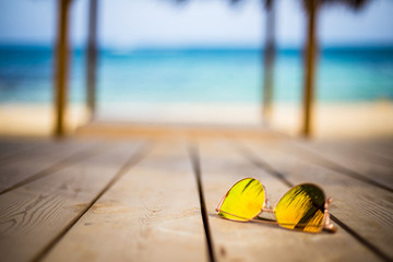 Summer Vacation - Yellow Glasses near the Sea
