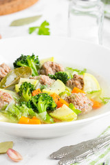 Vegetable soup with beef meatballs, carrots, cabbage, zucchini, broccoli, healthy homemade lunch