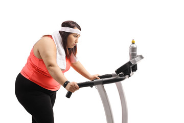Tired overweight woman on a treadmill