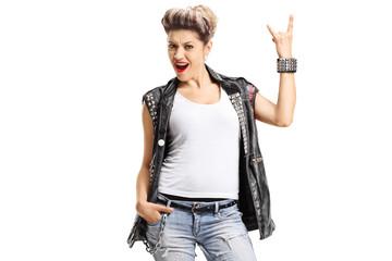 Female punker making a rock hand gesture