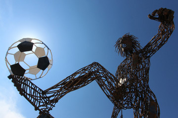 A statue depicting soccer player and made from the scrap metal is seen in Kazan