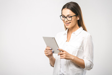 Portrait with copy space empty place of pretty charming confident trendy woman in classic shirt having tablet in hands isolated on white background