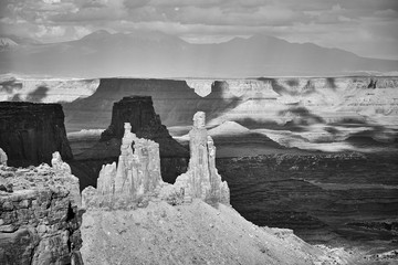 Black and white picture of deserted landscape in Canyonlands National Park at sunset, Island in the Sky region, Utah, USA.