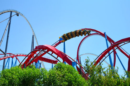 Big Roller Coaster in Amusement Park in a Sunny Day