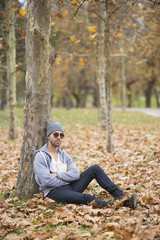 man in nature. autumn leaves. copy space