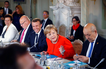 German Chancellor Angela Merkel and French President Emmanuel Macron attend the round table meeting with the Franco-German Ministerial Council in Meseberg
